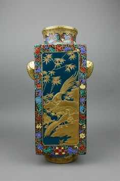 Chinese Famille Rose gilt porcelain vase; of square form with everted rim and two elephant-shaped handles on sides; featuring birds and flowers on body; six-character Qianlong mark on base; H: 36 cm, W: 20 cm, 4010 grams