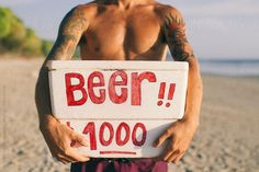 Beer boy with beer box in front of his chest  by Melchior   Stocksy United