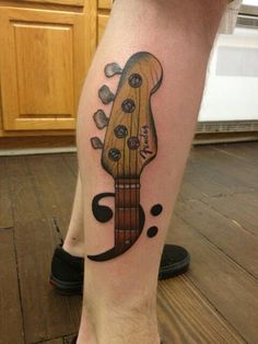 My 2nd tattoo done by Dean Denney at Anonymous Tattoo in Savannah, GA. I'm a bass player and really wanted a tattoo that would mark my first love (my Fender bass) and showcase my hobby. So Dean drew this up for me and I fell in love