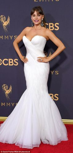 Flaunting it: The 45-year-old actress looked breathtaking in a figure-hugging strapless wh...