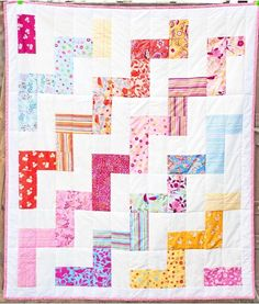Use your favorite charm packs to create this beautiful, breezy Charming Zigzag Quilt Pattern.