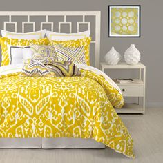 Loving this yellow + gray color combo, these fun patterns, and that modern headboard!