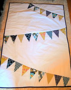Away We Go: Baby Quilt  (This would be cute with dangly pennants that aren't sewn down completely.)