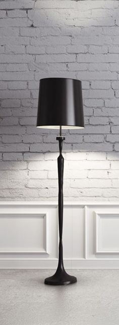 Mixed Feelings   A white wall is the perfect background for a total black floor lamp with a curved lampshade, a stunning piece for a living room.