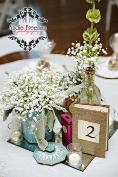 Reception tablescapes with low baby's breath centerpieces in blue wedgewood vases.  Burlap wrapped vintage books for table numbers.  Classic Shabby Chic Fall Wedding. Photography: Andie Freeman Photography www.TheAthensWeddingPhotographer.com Wedding Planning and Coordinating: www.WildflowerEventServices.com Venue and Floral: The Thompson House and Gardens