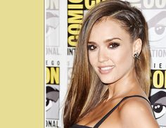 "How To Wear A Cool-Girl Braid Like Jessica Alba: ""I created a part beginning at the top of her head, all the way down to the nape of her neck [Then], on the left side, I sprayed John Frieda Spiral Style Spray Gel ($7) and created a flat braid down the left side, from the front to the back of her head."" He secured the braid with a small rubber band, then tucked it underneath the loose hair from the right side..."