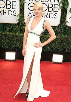 Margot Robbie  like the cut and crystals custom-designed, cream silk crepe Gucci gown, embroidered by crystal and emerald appliques