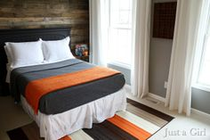 I am in love with this wall treatment and I love the colors of this boy's room