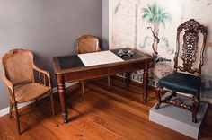Table and Chairs used to draft South Carolina's Ordinance of Secession in Charleston on December 20, 1860. The tall-back chair (at right) was used by D.F. Jamison, president of the Secession Convention, at the signing of the Ordinance at Institute Hall on Meeting Street. Charleston Museum.