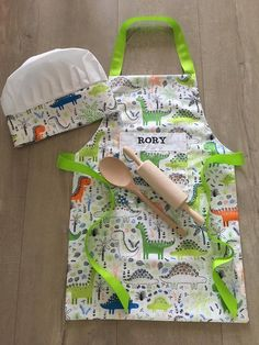 Personalised Children's Apron and Chef's hat baking set dinosaur print Sewing Ideas, Sewing Crafts, Sewing Projects, Sewing Patterns, Embroidered Apron, Childrens Aprons, Bbq Apron, Baking Set, Messy Play