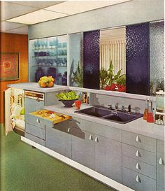 blue kitchen with teardrop shaped drawer pulls (Practical Encyclopedia of Good Decorating and Home Improvement, 1970)