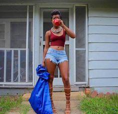 Dej Loaf's street style dressed in shorts and gladiator sandals