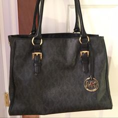 WELL KEPT Michael Kors Logo Handbag GREAT CONDITION, GENTLY USED, AUTHENTIC black logo Michael Kors Satchel with gold accents, tons of pockets and storage. Leather has been waterproofed & polished, lining is in perfect condition, all snaps, pockets and zippers in perfect condition. Michael Kors dust bag included. Michael Kors Bags Shoulder Bags
