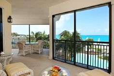 Mom, this is Mark's mom and dads exact place.  Remember the furniture, lol!  Nice find!!  THE SANDS ON GRACE BAY - Turks and Caicos