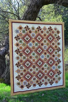 Butterscotch Baskets designed by Lynn Wilder for Sew'n Wild Oaks.  The patterns is available for sale at In Between Stitches.  The fabric is called Autumn Landscape by Lynette Jensen for RJR fabrics.