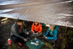 Camping in the Rain: Happy hour in the rain isn't working for your crew. They're heading to their tents to read alone with headlamps. The horror! What do you do? - Create an outdoor living room.