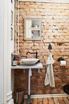 brick wall rustic bathroom