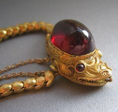 Serpent bracelet, circa 1845, garnet cabochon and gold chain - Victorian antique / vintage jewelry.