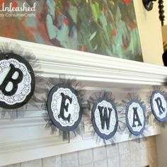 beware halloween banner. love this! i can't get my cameo blade to cut doily details like that but the tulle is awesome!