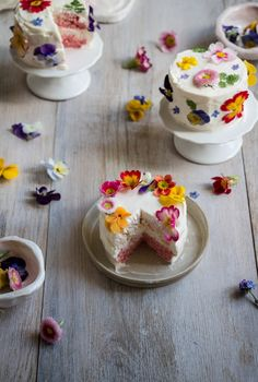 Simply frosted sponge cakes spring to vibrant life through a colorful sprinkling of palatable petals, which impart a range of fragrant, fresh-from-the-garden flavors and add a whiff of whimsy. Twigg Studios shares the recipe for these delightful little efflorescent treats.