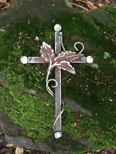 """This I Know"", a cross made from old industrial scrap iron and vintage New Orleans gate fragment. By Birmingham metal artist Catherine Partain Shamblin, 2015"