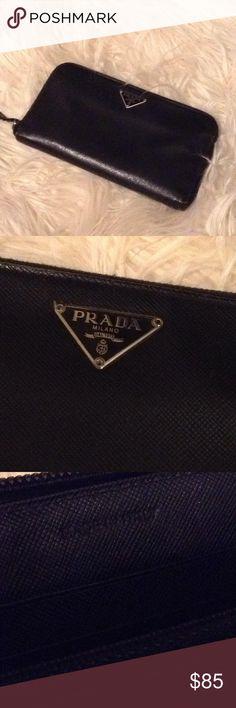 Prada wallet Authentic Prada wallet in fair condition, pull zipper disconnected. Prada Bags Wallets
