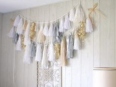 Tutorial to make a tissue paper tassel garland SIMILAR to Confetti Systems. The end result will look like mine which is in the picture below. Diy Tassel Garland, Tassels, Garland Ideas, Garlands, Confetti System, Diy And Crafts, Arts And Crafts, Tissue Paper Tassel, Deco Boheme