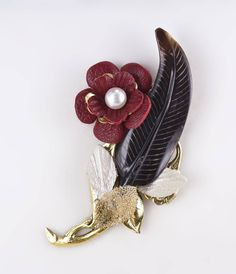 All dress is fancy dress is it not except our natural skins? Brass  #VARÓN Boutonniere with black accents and Red Floral detailing