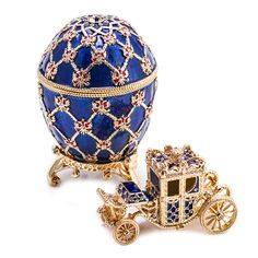 This beautiful Carriage Fabergé Style Easter Egg was inspired by the original Coronation Faberge Egg that was made by Faberge for the Russian imperial family. The original Coronation Egg was made in commemoration of the coronation ceremony of Nicholas II in 1896. This important symbol of the Russian history was presented as a gift to the Emperor's wife, Empress Alexandra Feodorovna.