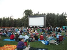 Movie in the Park.  Magnuson Park          http://www.epiceap.com/wp-content/uploads/2011/03/Seattle-Outdoor-Movies.jpg