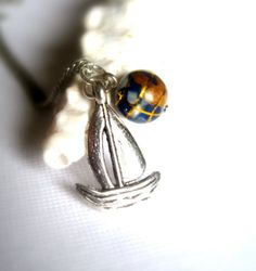 Sailing around the globe necklace by A Cup of Sparkle, $24