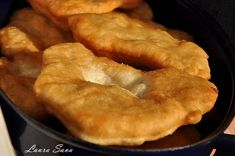 Langosi (fried dough filled with feta) Romanian Desserts, Romanian Recipes, Romania Food, Delicious Desserts, Dessert Recipes, Good Food, Yummy Food, Hungarian Recipes, Hungarian Food