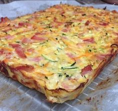 INGREDIENTS:  6 eggs  1 large zucchini grated  1 carrot grated  1/2 onion finely diced  1/2 cup grated cheese  300g thinly sliced bacon  Pinch of nutmeg and baking powder  Salt and pepper to taste    DIRECTIONS:  *In a large bowl beat the eggs and add nutmeg, salt,