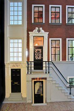 A Beautiful World. jt-Section of Canal House with additions. Love the doors and curtains which delicately drape inside. Stunning house!