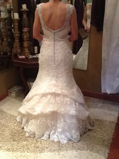 waterfall bustle with the lining bustled seperately. Mermaid style wedding gown