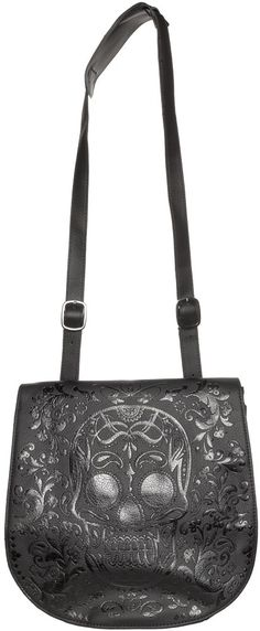 LOUNGEFLY BLACK SUGAR SKULL EMBOSSED CROSS BODY BAG Loungefly brings you the the Sugar Skull cross body bag! This textured faux leather purse with black on black embossed sugar skull & decorative filigree features snap closure, open main compartment, zipped smaller compartment along with a button compartment that would fit your cell phone perfectly. Buckled straps with three lengths. $56.00 #loungefly #sugarskull #crossbodybag #purse