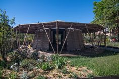 In pre-Islamic Arabia, a majlis was a place where people would come together to exchange ideas. They are common among nomadic communities, but could also be a part of the home or a more formal gathering space. Places Around The World, Around The Worlds, Bamboo Structure, Temporary Structures, Bamboo Architecture, Art Village, Desert Art, Venice Biennale, Local Events