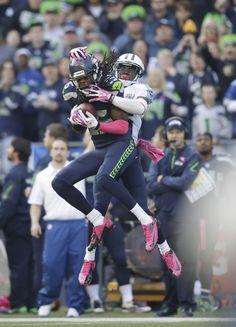 Seattle Seahawks cornerback Richard Sherman intercepts a pass intended for wide receiver Nate Washington. W6 (AP Photo/Scott Eklund)