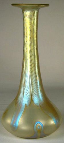 An extremely beautiful soliel fleur vase in pale opalescent pink glass with combed blue and platinum irridescence. Exceptionally well executed and controlled design. Perfect condition. Signed to the base Loetz Austria and date c1900