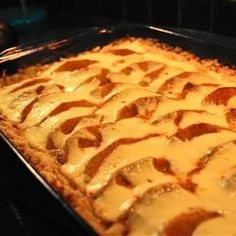 This is a quick and versatile recipe for a classic cake.  Substitute a 32 ounce can of pears and devil's food cake mix for Pear Kuchen, or canned peaches and white cake mix for a peach version.