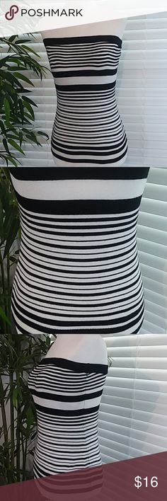 """White House Black Market Striped Knit Tube Top Black and White Knit Striped Tube Top from White House Black Market. Very Stretchy. 75% Rayon/21% Nylon/6% Spandex. All measurements are appoximate laying flat and unstretched. Armpit to Armpit 14"""". Length 15"""". Size S White House Black Market Tops"""