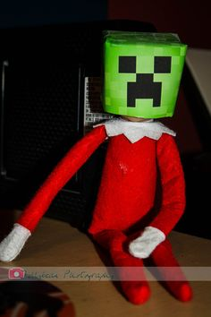 My boys are obsessed with Minecraft.  Buddy, our Elf on the Shelf, dressed up as a Minecraft creeper.  The squeals of excitement when they discovered him today was priceless.  The creeper head was made from a washed and dried juice box...cut to fit the Elf's head.  Searched Google images for a creeper, printed and taped to the juicebox...Voila!!