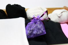 How to Use a Lavender Sachet: 7 Steps - wikiHow> Made Lavender sachets for family gifts using dark purple and pale lavender organza bags filled with Lavender from France.  Attached a charm on ribbon.  2013 gifts.