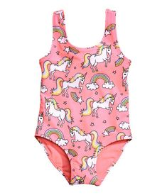 Pink/unicorn. Fully lined swimsuit with a printed design.