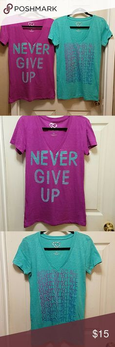 AEROPOSTALE TEES From the LIVE LOVE DREAM LINE~ comfy v-neck tees in beautiful colors❣  The first is a violet purple with dark mint green lettering outlined in silver metallic saying 'NEVER GIVE UP.'💜  The second is that mint green with different shades of purple lettering saying 'WITH LOVE DO ALL THINGS WITH LOVE.'💚  60% cotton 40% polyester.  I like wearing tanks underneath so I threw one in the last pic to show.  Also, I bought these to go with the AE sweats I'm selling separately…