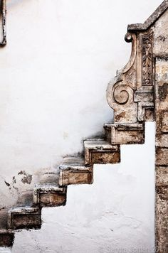 stairs: old stone rustic on white plaster walls (photo by sandra jordan 2011)