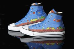 """Converse and Nintendo are celebrating the 25th anniversary of Super Mario with a trio of commemorative Chuck Taylor high-tops that're full of pixellated win."""