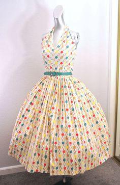 Totally fun 1950s atomic novelty print circle skirt, halter neck dress. #vintage #1950s #dresses #fashion
