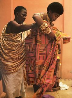 Queen mother being assisted to put on her Kente cloth as tradition and custom demands.  In its cultural context of use, Kente is more than just a cloth. Like most of Africa's visual art forms, Kente is a visual representation of history, philosophy, ethics, oral literature, religious belief, social values and political thought. Originally, its use was reserved for their royalty and limited to special social and sacred functions.