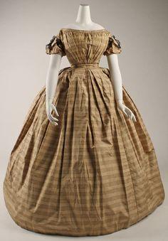Dress  Date: ca. 1860  Culture: American  Medium: silk, cotton